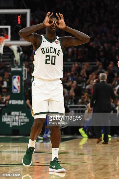 Marvin Williams of the Milwaukee Bucks reacts to a three point shot during the second half of a game against the Philadelphia 76ers at Fiserv Forum...