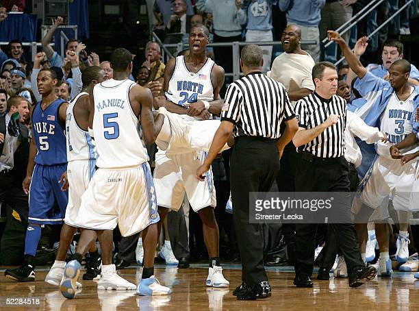 Marvin Williams of the North Carolina Tar Heels is held up by teammates after making the game-winning field goal against the Duke Blue Devils on...