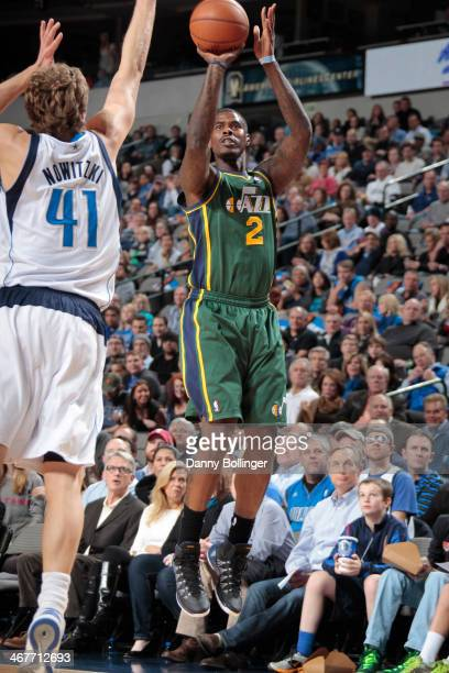 Marvin Williams of the Utah Jazz shoots a three against the Dallas Mavericks on February 7 2014 at the American Airlines Center in Dallas Texas NOTE...