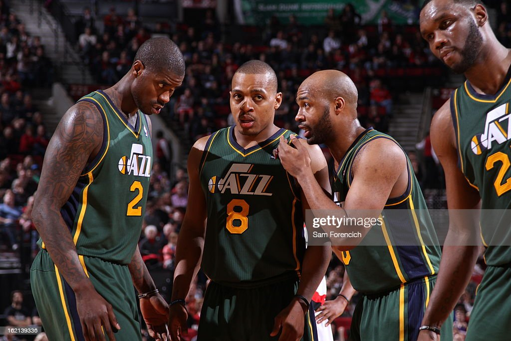 Marvin Williams #2, Randy Foye #8, Jamaal Tinsley #6 and Al Jefferson #25 of the Utah Jazz huddle up during the game against the Portland Trail Blazers on February 3, 2013 at the Rose Garden Arena in Portland, Oregon.