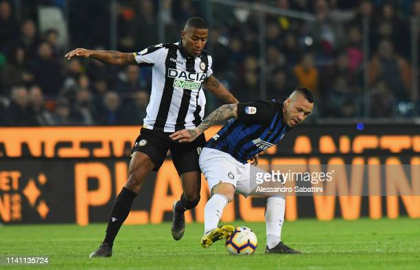 Marvin Zeegelaar of Udinese Calcio competes for the ball with Radja Nainggolan of FC Internazionale during the Serie A match between Udinese and FC...