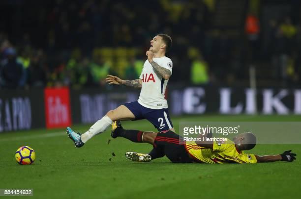 Marvin Zeegelaar of Watford fouls Kieran Trippier of Tottenham Hotspur during the Premier League match between Watford and Tottenham Hotspur at...