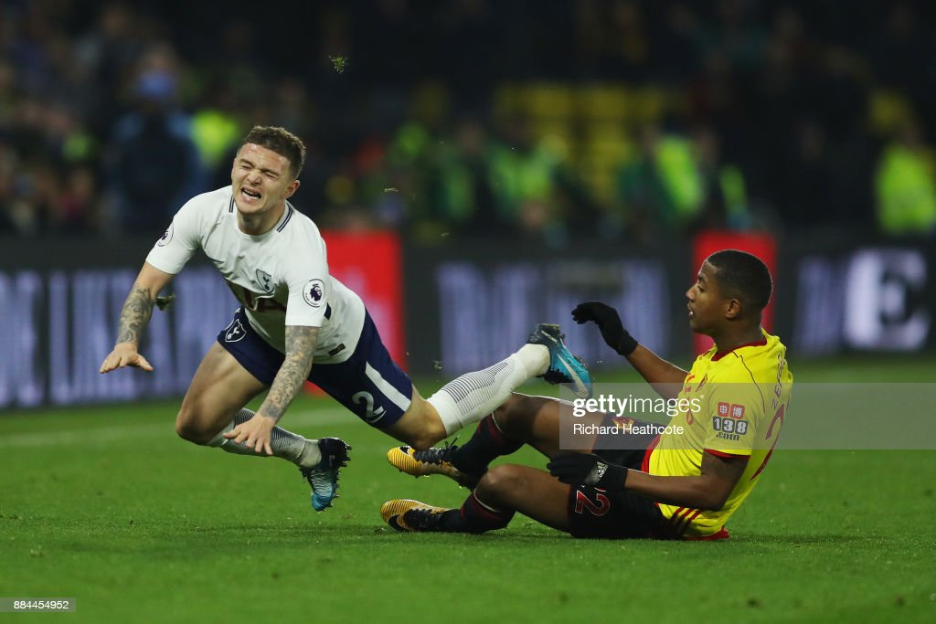 Marvin Zeegelaar of Watford fouls Kieran Trippier of Tottenham Hotspur during the Premier League match between Watford and Tottenham Hotspur at Vicarage Road on December 2, 2017 in Watford, England.