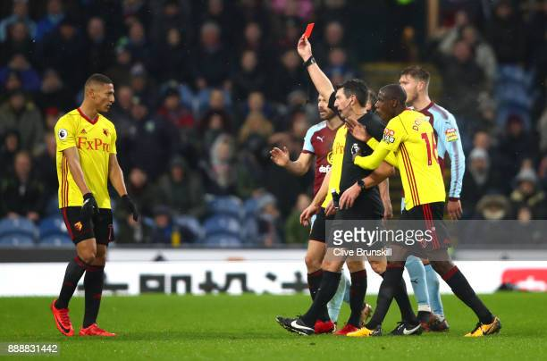 Marvin Zeegelaar of Watford is shown a red card by referee Lee Probert during the Premier League match between Burnley and Watford at Turf Moor on...