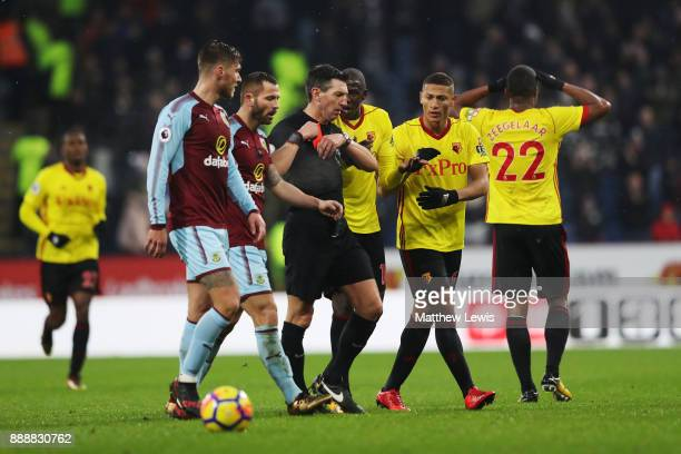 Marvin Zeegelaar of Watford reacts to being shown a red card by referee Lee Probert during the Premier League match between Burnley and Watford at...