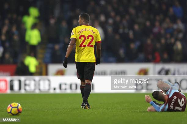 Marvin Zeegelaar of Watford walks off after fouling Steven Defour of Burnley which he later is sent off for during the Premier League match between...