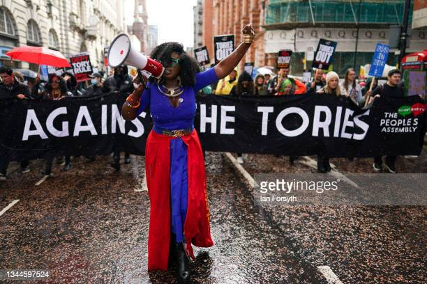 Marvina Newton from United for Black Lives Matter joins demonstrators from the People's Assembly during a march to protest against the Conservative...