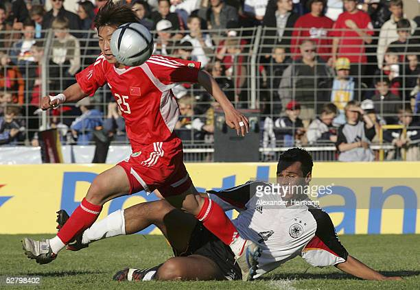 MarvinJob Matip of Germany tackles Lu Lin of China during the match between Germany and China in the men's under 20's International on May 11 2005 in...