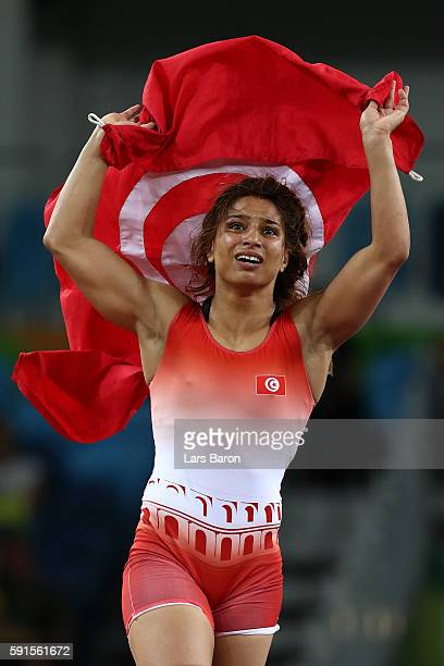 Marwa Amri of Tunisia celebrates defeating Yuliya Ratkevich of Azerbaijan during the Women's Freestyle 58 kg Bronze match on Day 12 of the Rio 2016...