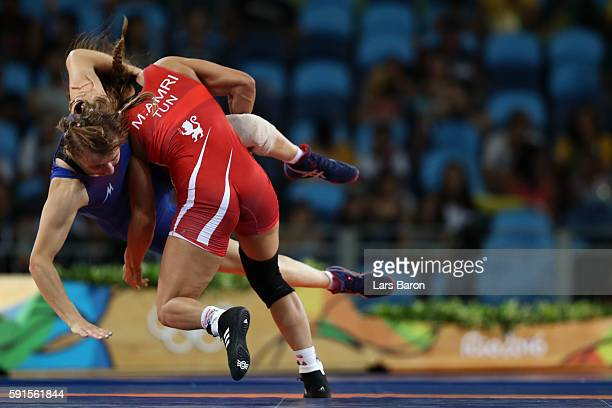 Marwa Amri of Tunisia competes against Yuliya Ratkevich of Azerbaijan during the Women's Freestyle 58 kg Bronze match on Day 12 of the Rio 2016...