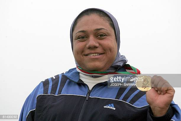 Marwa Arafat of Egypt poses with her gold medal after winning the hammer competition at the 10th Arab Games in Algiers 06 October 2004 AFP...