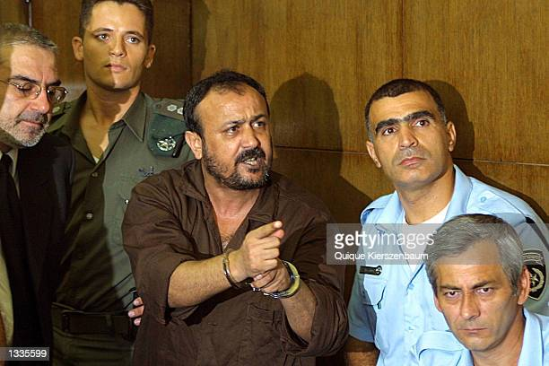 Marwan Barghouti the West Bank chief of Yasser Arafat's Fatah movement speaks with the media in the courtroom on the opening day of his court case at...