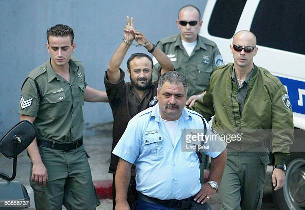 Marwan Barghoutti head of the Palestinian Fatah Tanzim and AlAqsa Martyrs' Brigades gestures as he is brought by Israeli police to the Tel Aviv...