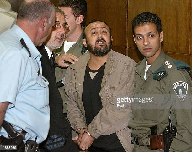 Marwan Barghuti shouts back to a Jewish man accusing him of the murder of 'our children' next to his lawyer Jawal Boulus at the district court...
