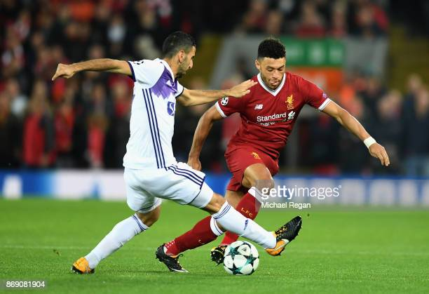 Marwan Kabha of NK Maribor and Alex OxladeChamberlain of Liverpool battle for possession during the UEFA Champions League group E match between...