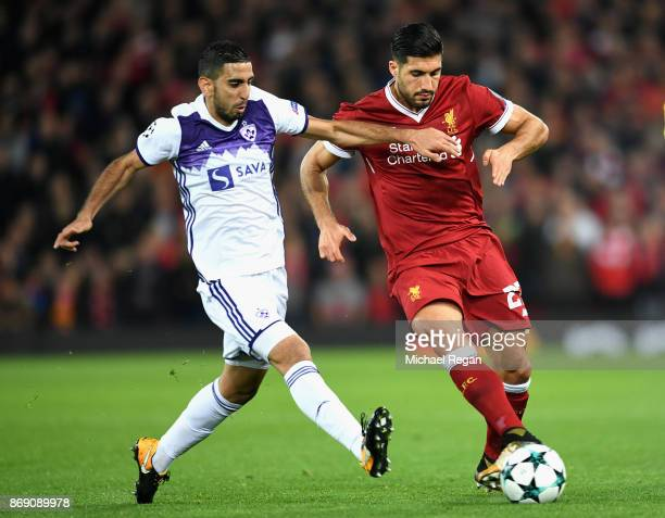 Marwan Kabha of NK Maribor and Emre Can of Liverpool battle for possession during the UEFA Champions League group E match between Liverpool FC and NK...