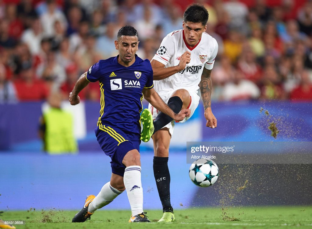 Marwan Kabha of NK Maribor (L) competes for the ball with Joaquin Correa of Sevilla FC (R) during the UEFA Champions League match between Sevilla FC and NK Maribor at Estadio Ramon Sanchez Pizjuan on September 26, 2017 in Seville, Spain.