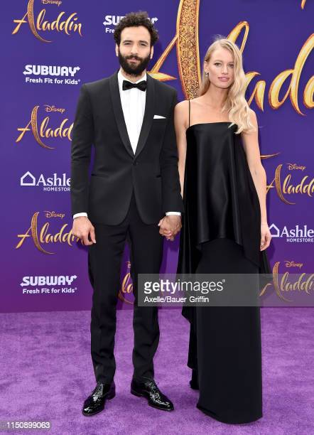 Marwan Kenzari and Nora Ponse attend the premiere of Disney's Aladdin on May 21 2019 in Los Angeles California