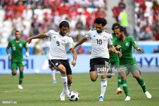 Marwan Mohsen of Egypt passes the ball to Mohamed Salah of Egypt during the 2018 FIFA World Cup Russia group A match between Saudia Arabia and Egypt...