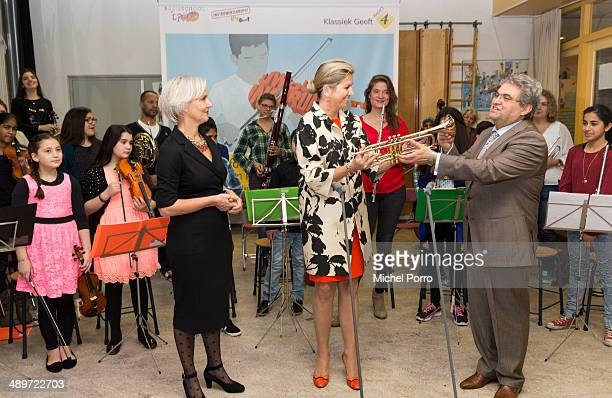 Marwil Straat Queen Maxima of The Netherlands and Marco de Souza attends the kick off of a national campaign to collect instruments for musical...