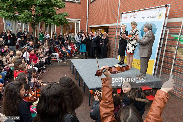 Marwil Straat Queen Maxima of The Netherlands and Marco de Souza listen to children playing instruments during the kick off of a national campaign to...