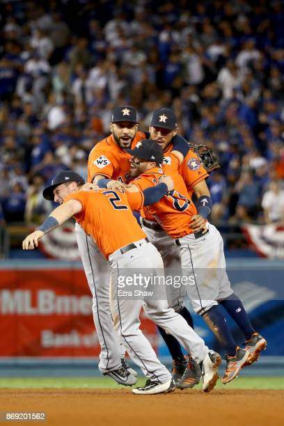 Marwin Gonzalez, Alex Bregman, Jose Altuve, and Carlos Correa of the Houston Astros celebrate defeating the Los Angeles Dodgers 5-1 in game seven to...