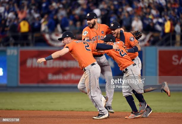 Marwin Gonzalez, Alex Bregman, Jose Altuve and Carlos Correa of the Houston Astros celebrate after the final out of Game 7 of the 2017 World Series...