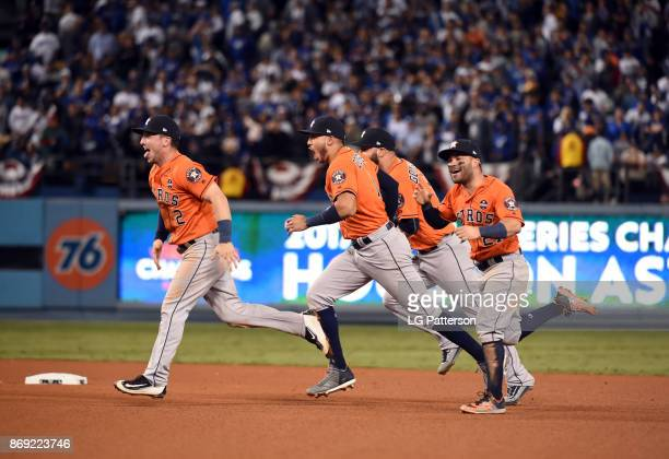 Marwin Gonzalez Alex Bregman Jose Altuve and Carlos Correa of the Houston Astros celebrate after the final out of Game 7 of the 2017 World Series...