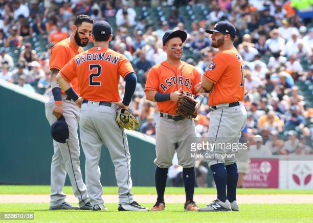 Marwin Gonzalez Alex Bregman Jose Altuve and Tyler White of the Houston Astros stand together on the field during the game against the Detroit Tigers...