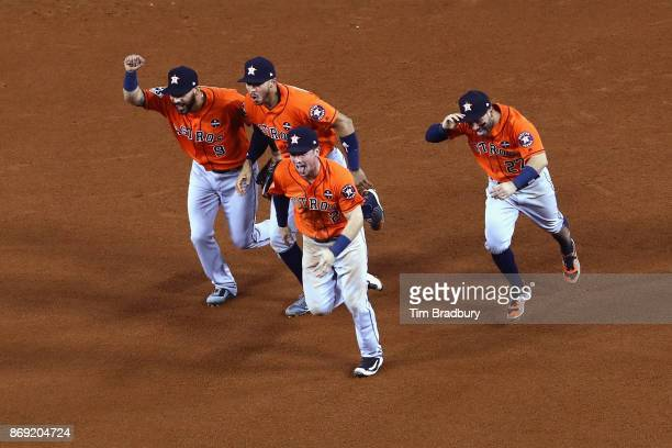Marwin Gonzalez Carlos Correa Alex Bregman and Jose Altuve of the Houston Astros celebrate defeating the Los Angeles Dodgers 51 in game seven to win...
