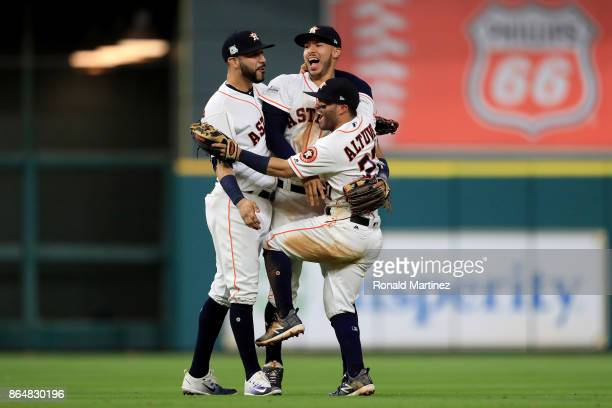 Marwin Gonzalez Carlos Correa and Jose Altuve of the Houston Astros celebrate after defeating the New York Yankees by a score of 40 to win Game Seven...