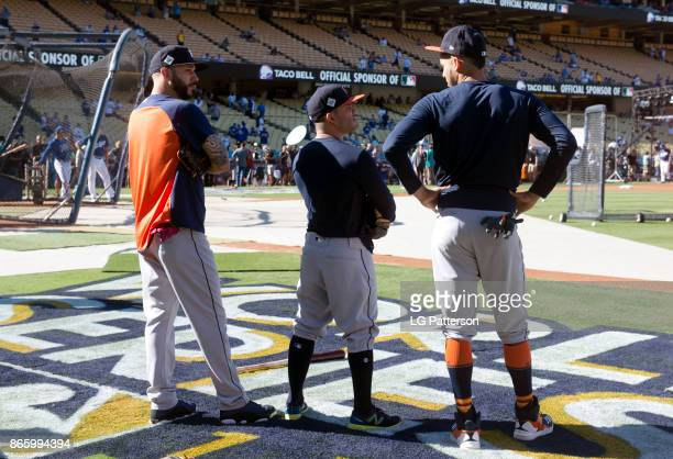 Marwin Gonzalez Jose Altuve and Carlos Correa of the Houston Astros talk during batting practice prior Game 1 of the 2017 World Series against the...