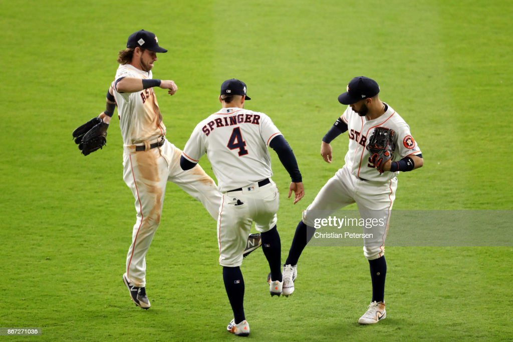 Marwin Gonzalez #9, Josh Reddick #22 and George Springer #4 of the Houston Astros celebrate after defeating the Los Angeles Dodgers in game three of the 2017 World Series at Minute Maid Park on October 27, 2017 in Houston, Texas. The Astros defeated the Dodgers 5-3.