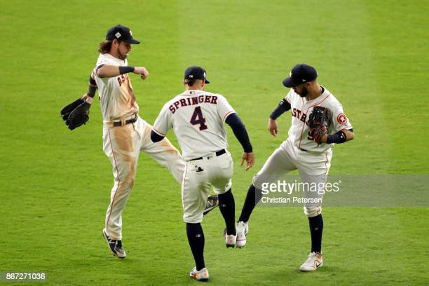 Marwin Gonzalez Josh Reddick and George Springer of the Houston Astros celebrate after defeating the Los Angeles Dodgers in game three of the 2017...