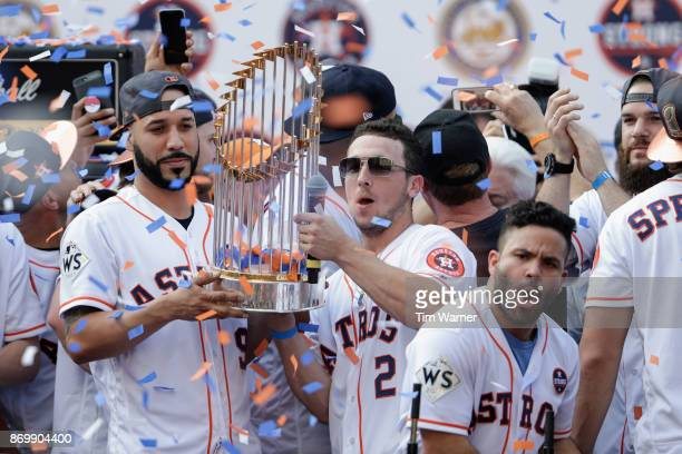 Marwin Gonzalez of the Houston Astros and Alex Bregman hold the World Series Trophy during the Houston Astros Victory Parade on November 3 2017 in...