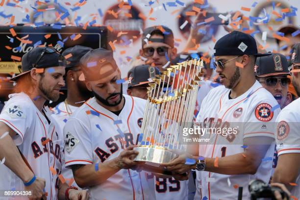Marwin Gonzalez of the Houston Astros and Carlos Correa hold the World Series Trophy during the Houston Astros Victory Parade on November 3 2017 in...