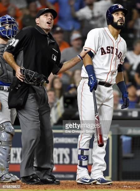 Marwin Gonzalez of the Houston Astros and home plate umpire Pat Hoberg watch Gonzalez's grand slam during the eighth inning against the Texas Rangers...