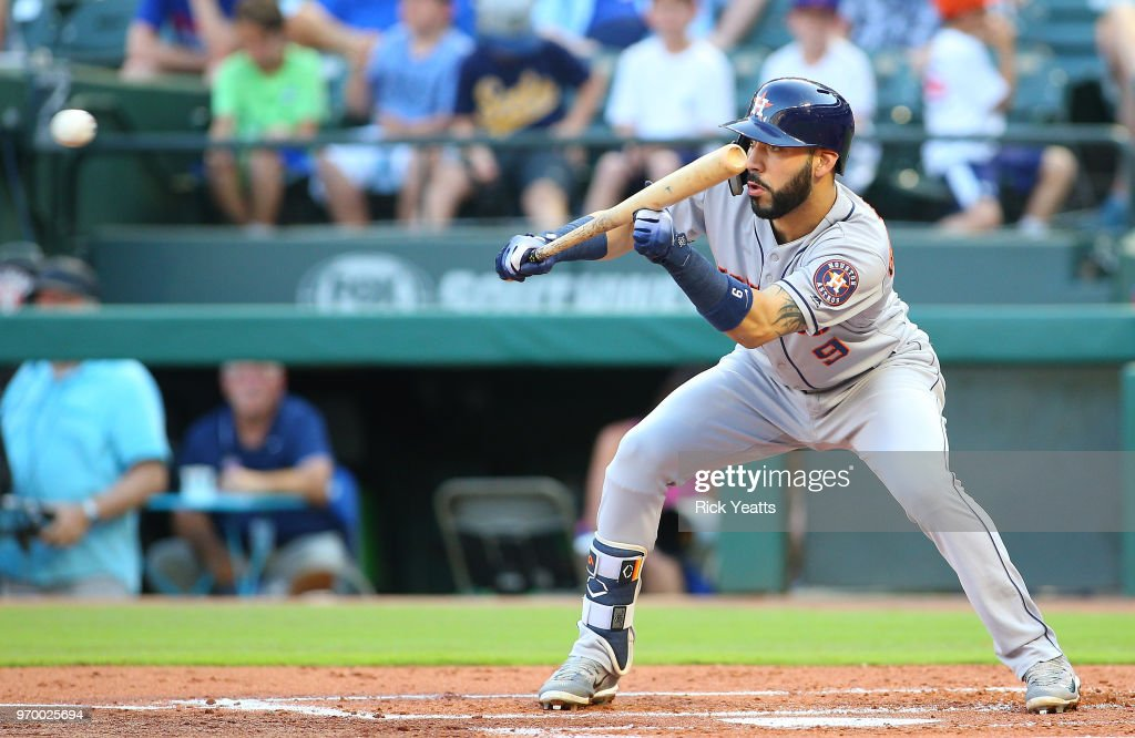 Marwin Gonzalez #9 of the Houston Astros bunts in the second inning against the Texas Rangers at Globe Life Park in Arlington on June 8, 2018 in Arlington, Texas.