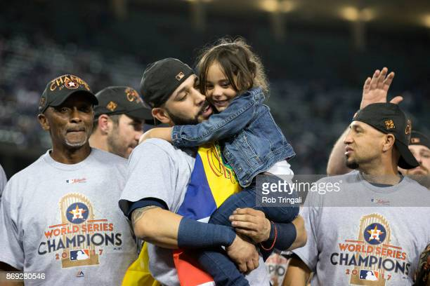 Marwin Gonzalez of the Houston Astros celebrates on the field with his daughter after the Astros defeated the Los Angeles Dodgers in Game 7 of the...