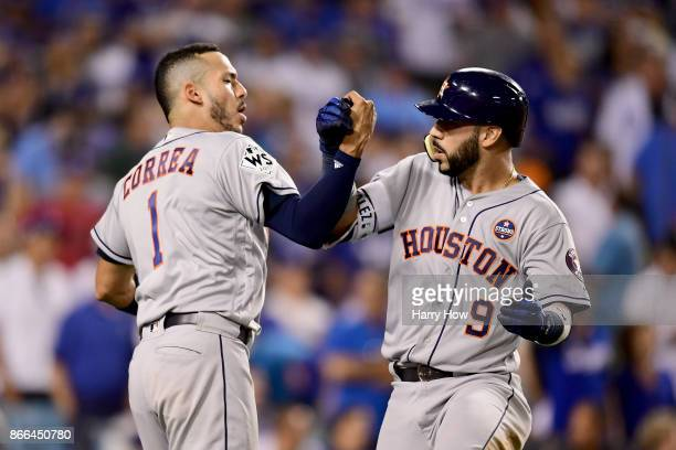 Marwin Gonzalez of the Houston Astros celebrates with Carlos Correa after hitting a solo home run during the ninth inning against the Los Angeles...