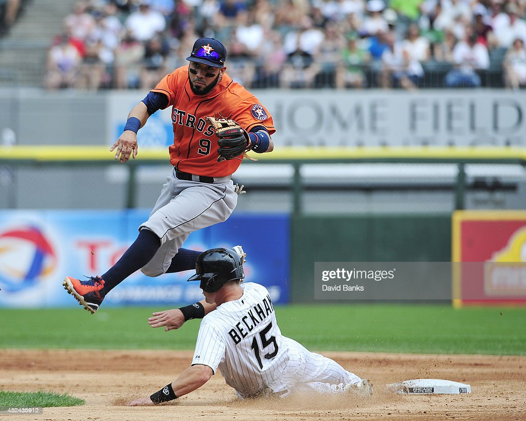 Marwin Gonzalez #9 of the Houston Astros forces out Gordon Beckham #15 of the Chicago White Sox during the second inning on July 20, 2014 at U.S. Cellular Field in Chicago, Illinois.