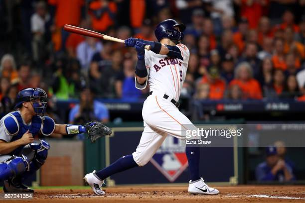 Marwin Gonzalez of the Houston Astros hits a RBI single during the second inning against the Los Angeles Dodgers in game three of the 2017 World...