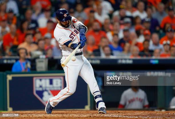 Marwin Gonzalez of the Houston Astros hits a tworun RBI double in the fourth inning against the Boston Red Sox during game one of the American League...