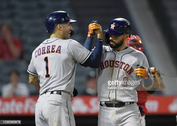 Marwin Gonzalez of the Houston Astros is congratulated by Carlos Correa after hitting a grand slam home run against relief pitcher Jose Marte of the...