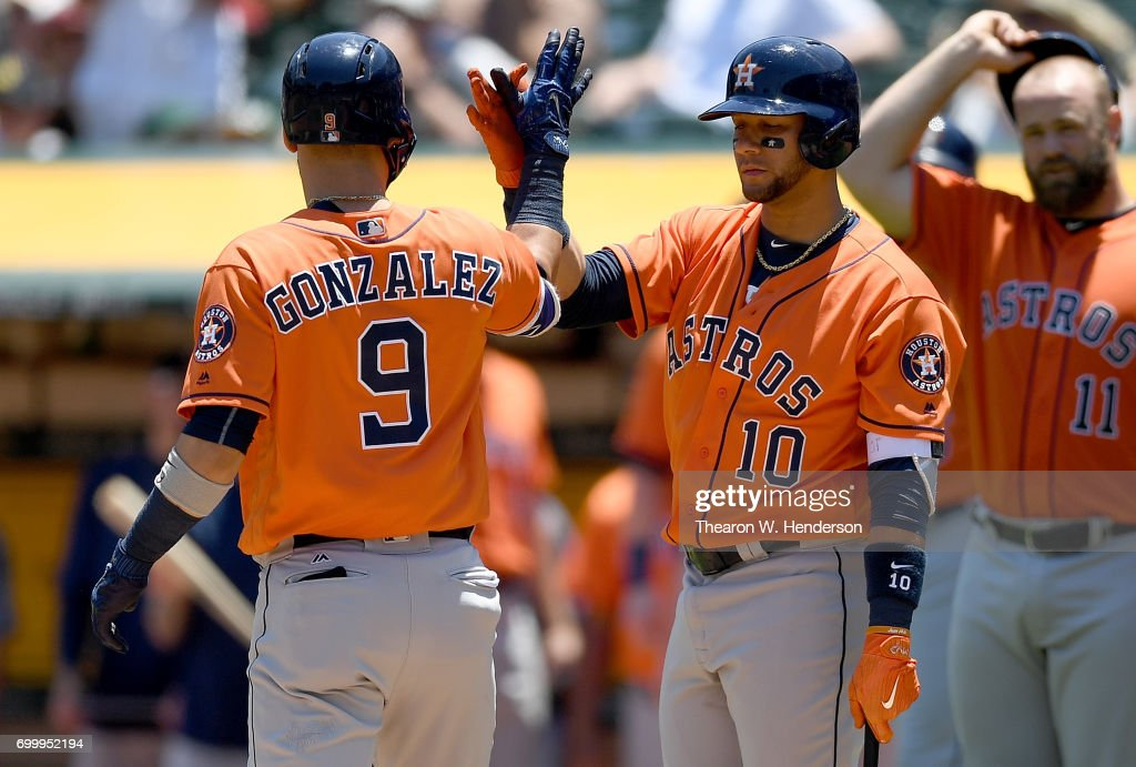 Marwin Gonzalez #9 of the Houston Astros is congratulated by Yuli Gurriel #10 after Gonzalez hit a three-run homer against the Oakland Athletics in the top of the second inning at Oakland Alameda Coliseum on June 22, 2017 in Oakland, California.