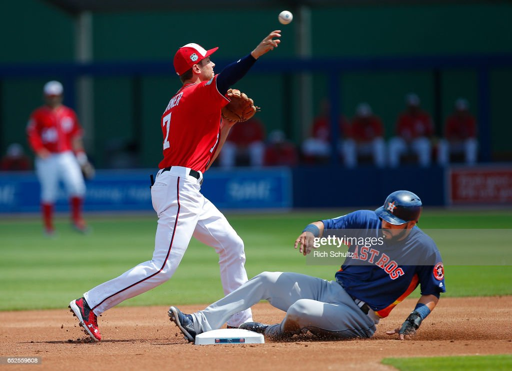 Marwin Gonzalez #9 of the Houston Astros is forced out at second base by shortstop Trea Turner #7 of the Washington Nationals on a fielders choice hit by Josh Reddick #22 during the first inning of a spring training baseball game on March 12, 2017 in West Palm Beach, Florida.