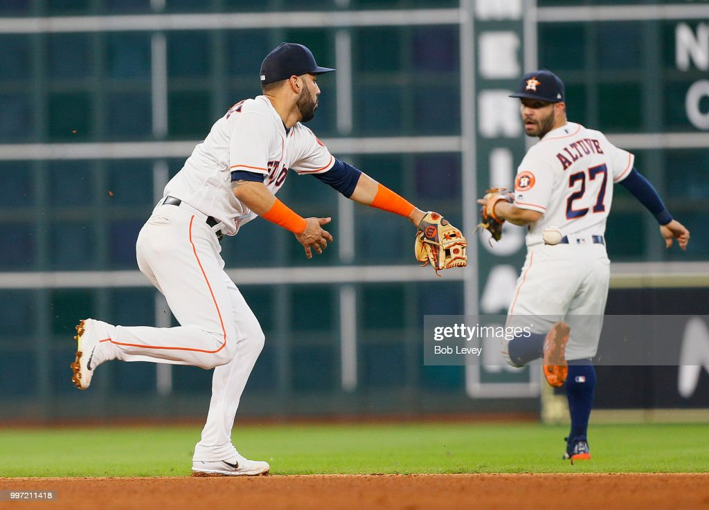Marwin Gonzalez #9 of the Houston Astros is unable get his glove on a ball hit by Stephen Piscotty #25 of the Oakland Athletics in the fifth inning at Minute Maid Park on July 12, 2018 in Houston, Texas.