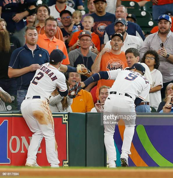 Marwin Gonzalez of the Houston Astros makes a catch in foul territory on a fly ball by Brandon Belt of the San Francisco Giants in the sixth inning...