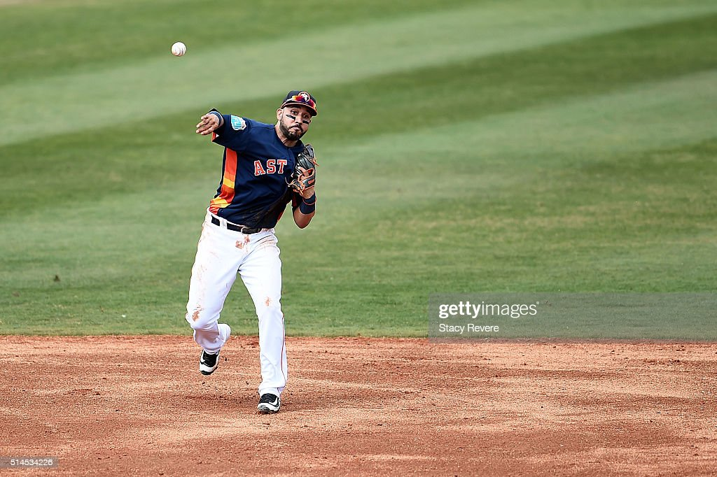 Marwin Gonzalez #9 of the Houston Astros makes a throw to first base during the third inning of a spring training game against the Atlanta Braves at Osceola County Stadium on March 9, 2016 in Kissimmee, Florida.