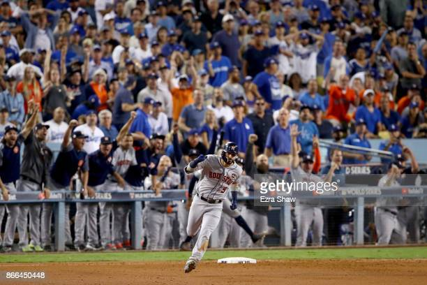 Marwin Gonzalez of the Houston Astros runs the bases after hitting a solo home run during the ninth inning against the Los Angeles Dodgers in game...